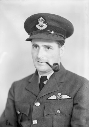 Close up of RAF Officer with pipe in his mouth.