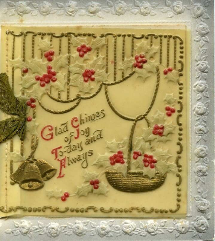 Christmas greeting card featuring bells and holly designs on plastic.