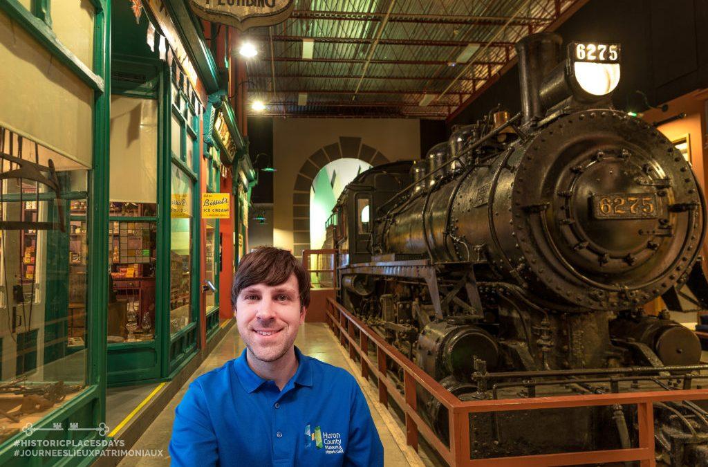 Programming Coordinator Dan taking a selfie in front of the Museum train